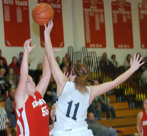 WARREN DILLAWAY / Star Beacon<br /> CORTNEY HUMPHREY (55) of Edgewood shoots as Angela Cole (11) of Conneaut goes for the block on Friday night during the Edgewood Preview.