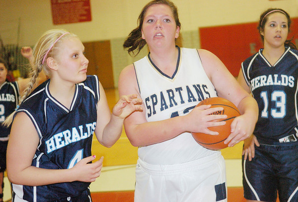WARREN DILLAWAY / Star Beacon<br /> CARLY KAY (with ball) of Conneaut looks to the referee with Liv Cimorelli (4) and St. John teammate RaeAnn Benedict on Friday night during the Edgewood Preview.