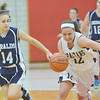 WARREN DILLAWAY / Star Beacon<br /> BROOKE BENNETT (12) of Conneaut leads a fast break with  Jessica DiSalvatore (14) of St. John in hot pursuit on Friday night during the Edgewood preview.