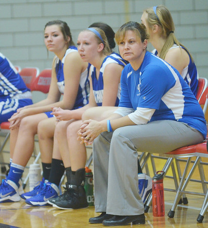 WARREN DILLAWAY / Star Beacon<br /> KIM TRISKETT, Grand Valley girls basketball coach, watches the action on Friday evening during the Edgewood Preview.