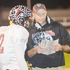 WARREN DILLAWAY / Star Beacon<br /> JEFFERSON FOOTBALL Coach Jimmy Henson talks with quarterback Cole Erdel on Friday during a game at Conneaut.