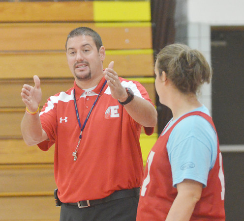 WARREN DILLAWAY / Star Beacon<br /> STEVE KRAY, Edgewood girls basketball coach, makes a point as Courtney Humphrey watches during a Friday afternoon practice.