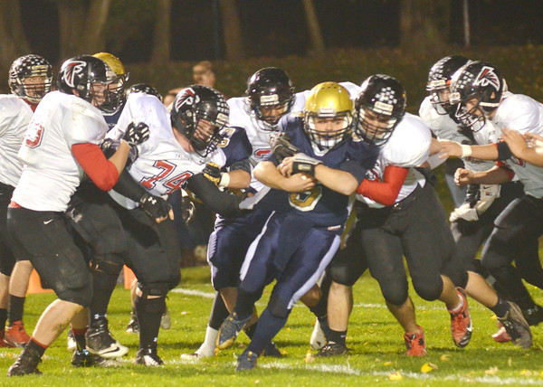 WARREN DILLAWAY / Star Beacon<br /> TROY COLUCCI (with ball) of Conneaut is surrounded by a host of Jefferson defenders on Friday night at Conneaut.