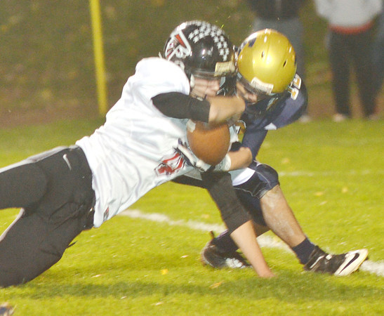 WARREN DILLAWAY / Star Beacon<br /> LUCAS HITCHCOCK (left) of Jefferson collides  with C.J. Rice of Conneaut on Friday night at Conneaut.