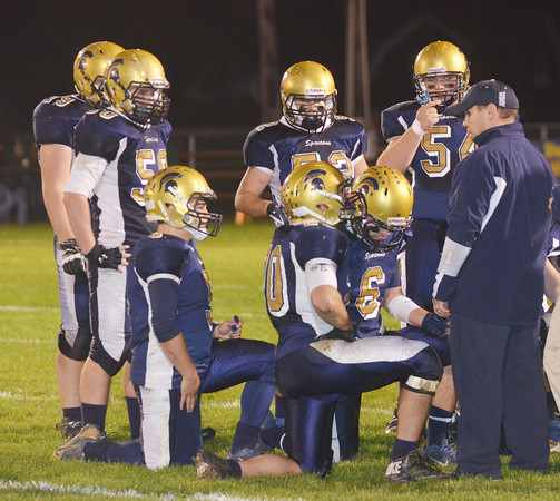 WARREN DILLAWAY / Star Beacon<br /> ROCCO DURBAN, Conneaut football coach, talks to his team during a timeout on Friday night during a home game with Jefferson.