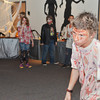 WARREN DILLAWAY / Star Beacon<br /> JIMMY TODD, an eighth grader at Conneaut Middle School, displays his Zombie walk on Friday during Zombie IInfestation at the Conneaut Pulbic  Library. Todd won the contest and the home made trophy that went with it.