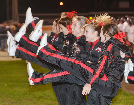 WARREN DILLAWAY / Star Beacon<br /> JEFFERSON CHEERLEADERS work on a kick line on Friday during a football game at Conneaut.