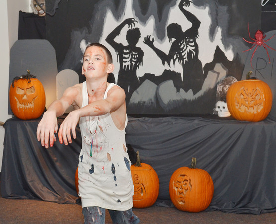 WARREN DILLAWAY / Star Beacon<br /> KENNETH MCCUMBER, an eighth grader at Conneaut Middle School, displays his Zombie walk on Friday during Zombie IInfestation at the Conneaut Pulbic  Library.