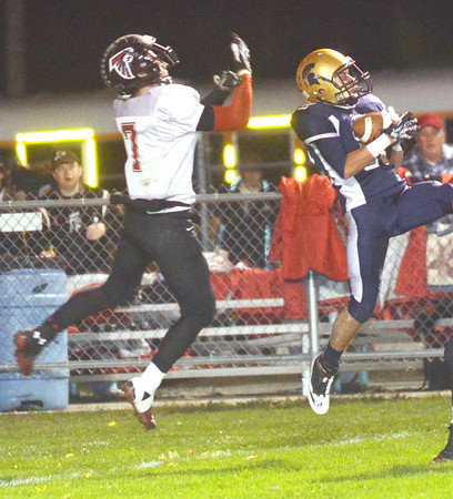 WARREN DILLAWAY / Star Beacon<br /> ISIAH NGRAINGAS (right) of Conneaut intercepts a pass in front of Cody Campbell of Jefferson on Friday night at Conneaut.