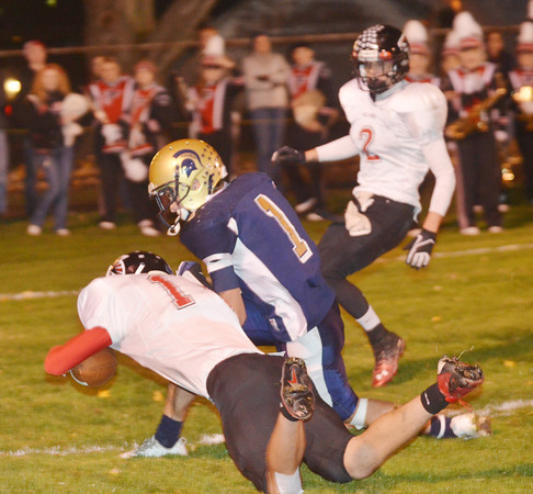 WARREN DILLAWAY / Star Beacon<br /> AUSTIN PATTON (left with ball) of Jefferson dives for an extra yard to set up a second quarter touchdown as Alex Gerdes of Conneaut briiiings him down on Friday night at Conneaut. Cole Erdel (2) of Jefferson follows the play.