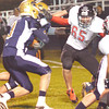 WARREN DILLAWAY / Star Beacon<br /> C.J. RICE (3) of Conneaut tries to find a hole as Josh Hall (65) of Jefferson blocks his path on Friday night at Conneaut.
