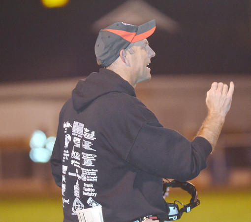 WARREN DILLAWAY / Star Beacon<br /> JIMMY HENSON, Jefferson football coach, gestures to his team on Friday night during a game at Conneaut.