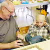 WARREN DILLAWAY / Star Beacon<br /> JON SCHLICK, 5, is all dressed up fora Thanksgiving Day dinner for grandparents  Tuesday at Karing Ways Pre-School in Conneaut as his grandfather <br /> Chuck Schlick ties his shoes.