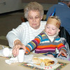WARREN DILLAWAY / Star Beacon<br /> FRANCES HOLDEN and her great niece Anna Mae Grace Holden, 3, both of Conneaut, enjoy a Thanksgiving Day dinner for grandparents and other relatives Tuesday at Karing Ways Pre-School in Conneaut.
