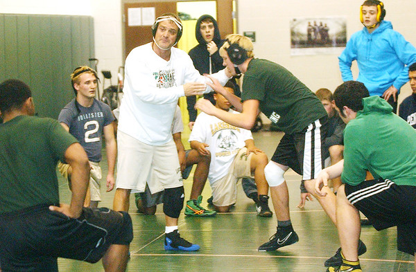 WARREN DILLAWAY / Star Beacon<br /> JERRY BRADY, new head wrestling coach at Lakeside, instructs his team with Jacob Cartner Tueday during practice.