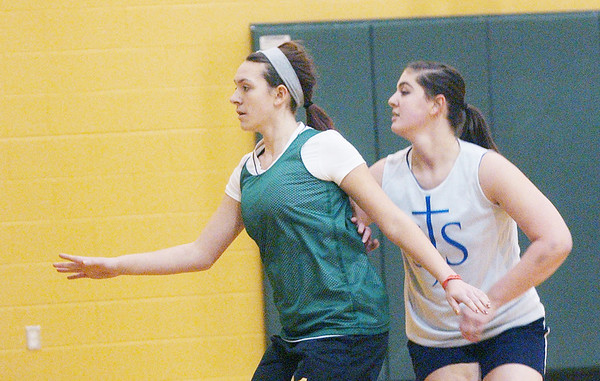 WARREN DILLAWAY / Star Beacon<br /> ALEXIS BENEDICT (left) of Lakeside and Mackenzie Stenroos of  St. John High School grapple for position Tuesday during a scrimmage at Lakeside.