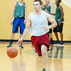 WARREN DILLAWAY / Star Beacon<br /> CHAD MCAFEE dribbles up court Tuesday during a Lakeside basketball practice.