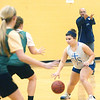 WARREN DILLAWAY / Star Beacon<br /> EMILY POWERS of St. John dribbles the ball while her coach Nick Iarocci gestures Tuesday during a scrimmage at Lakeside.