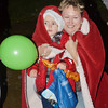 WARREN DILLAWAY / Star Beacon<br /> TAMMY MILLER huddles with her grandson Braylen Petery, 4, of Ashtabula, on Friday evening during the Ashtabula Christmas parade.
