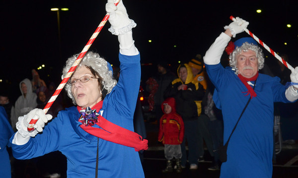 WARREN DILLAWAY / Star Beacon<br /> JAN BABER (left) and Troy Bailey perform with the Ashtabula Senior Center during the Ashtabula Christmas Parade on Friday evening.