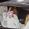 WARREN DILLAWAY / Star Beacon<br /> CHRISTIAN FAITH ACADEMY children try to stay dry during a rainy Ashtabula Christmas parade on Friday evening.