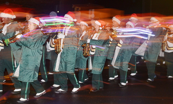 WARREN DILLAWAY / Star Beacon<br /> MEMBERS OF the Lakeside High School band bring holiday cheer to the Ashtabula Christmas parade Friday evening.