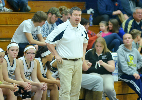 WARREN DILLAWAY / Star Beacon<br /> TONY PASANEN, Conneaut girls basketball coach, instructs his team on Saturday during a home game against Jefferson.
