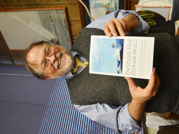 WARREN DILLAWAY / Star Beacon<br /> KYLE SMITH, a Jefferson based attorney, displays a book of poetry he recently published detailing experiences sailing on Lake Erie.