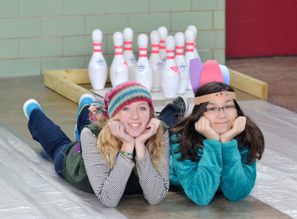 WARREN DILLAWAY / Star Beacon<br /> TIANNA ANTHONY, 14, and Tori Muehlbauer, 13, both of Howland, pose for a picture prior to a turkey bowling competition at Lighthouse Harvest Foundation in Astabula Township on Saturday.