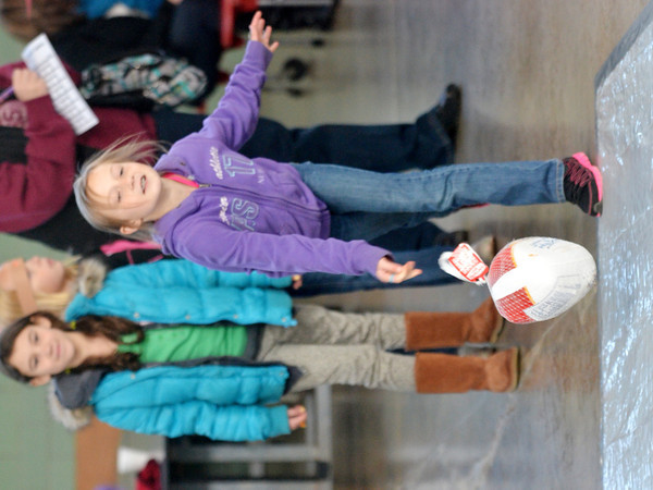 WARREN DILLAWAY / Star Beacon<br /> BODEY BECKWITH, 9, of Jefferson, releases her turkey during turkey bowling at Lighthouse Harvest Foundation on Saturday. The event was sponsored by girl scout troop 80103.