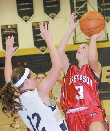 WARREN DILLAWAY / Star Beacon<br /> JESSICA BECKER (3) of Jefferson drives to the basket as Brooke Bennett of Conneaut defends on Saturday night at Garcia Gymnasium.