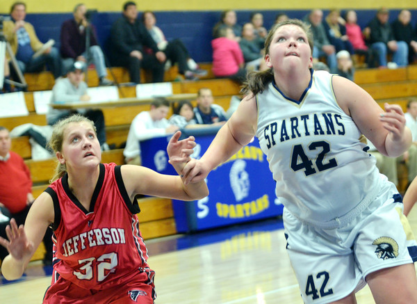 WARREN DILLAWAY / Star Beacon<br /> RAQUEL FULARZ (left) of Jefferson and Carla Kay of Conneaut fight for position on Saturday at Garcia Gymnasium.