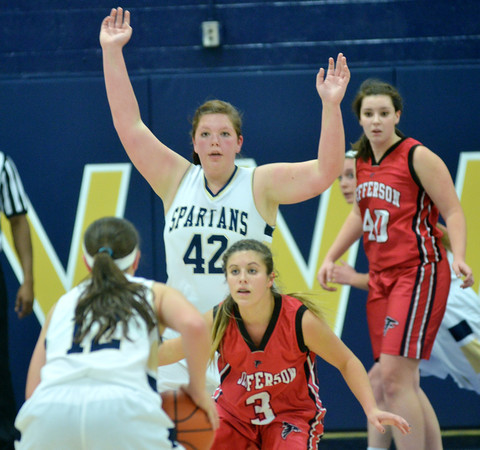 WARREN DILLAWAY / Star Beacon<br /> JESSICA BECKER (3) of Jefferson defeds  Brooke Bennett (12) of Conneaut as Carly Kay (42) of Conneaut gets position on Saturday night at Garcia Gymnasium.