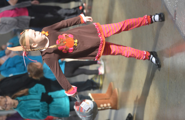 WARREN DILLAWAY / Star Beacon<br /> SYDNEY PARK, 7, of Geneva, prepares to release her frozen turkey during turkey bowling on Saturday at Lighthouse Harvest Foundation in Ashtabula Township. The event was sponsored by girl scout troop 80103.