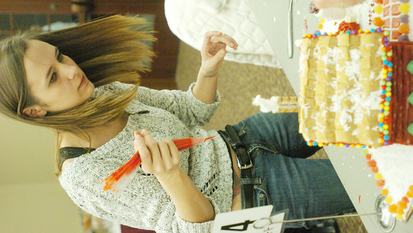 WARREN DILLAWAY / Star Beacon<br /> SHAUNA KRAFFT of Cortland works on a unique creation during the Gingerbread Challenge at the Lodge and Convention Center at Geneva-on-the-Lake Saturday.