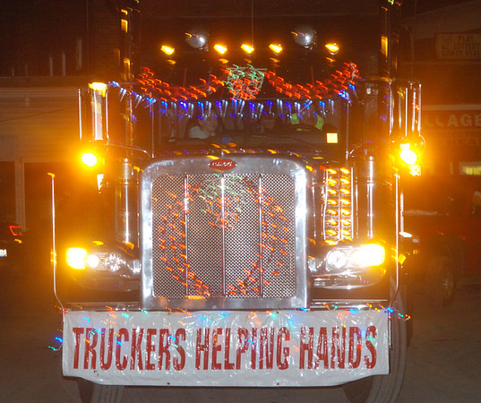 WARREN DILLAWAY / Star Beacon<br /> A TRUCKERS Helping Hands unit in the Andover Christmas Parade was colorfully decorated for the holiday season.