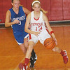 WARREN DILLAWAY / Star Beacon<br /> LINSEY MAYLE (13) of Geneva dribbles by Lakeview's Abby Pavlik Saturday night at Geneva.