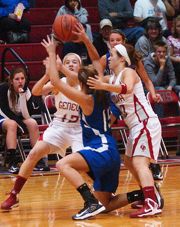 WARREN DILLAWAY / Star Beacon<br /> ALLIE PAVLIK (15) of Lakeview is surrounded by Geneva defenders Lindsey Mayle (left) and SarahDepp (right) Saturday night at Geneva.