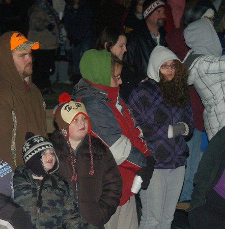WARREN DILLAWAY / Star Beacon<br /> CHILDREN AND Parents wait in line to see Santa Saturday night on the Andover Village Square.