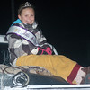 WARREN DILLAWAY / Star Beacon<br /> ASHA HAMILTON, Little Miss Pymatuning, smiles while riding on a truck during the Andover Christmas Parade Saturday evening.