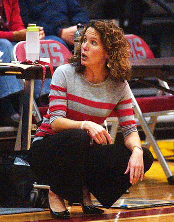 WARREN DILLAWAY / Star Beacon<br /> NANCY BARBO, Geneva girls basketball coach, talks to an assistant Friday night during a home game with Lakeview.