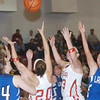 WARREN DILLAWAY / Star Beacon<br /> THE BALL was up in the air Saturday night as Cortland Lakeview teammatesMarissa Naples (34) and Abby Pavlik reach for the ball with Geneva's Lyndsey Armstrong (20) and Natalie Thomas (second from right) Saturday night at Geneva.