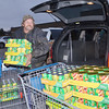 WARREN DILLAWAY / Star Beacon<br /> BRUCE LOTT of Jefferson loads food during a shopping trip for the Harassmeents Food Drive on Monday evening in Ashtabula Township.