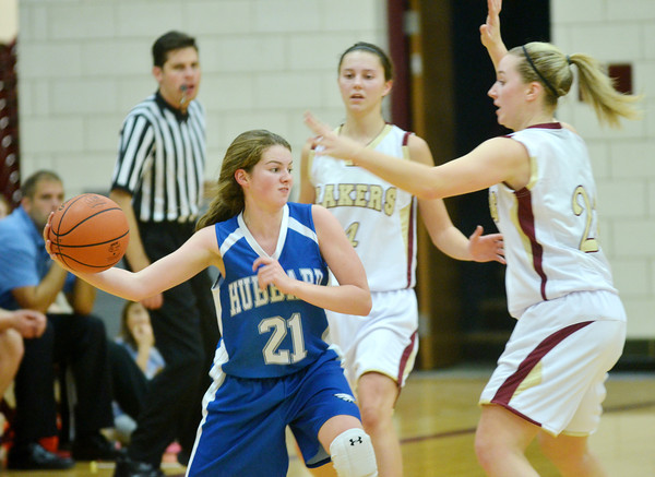 WARREN DILLAWAY / Star Beacon<br /> LOGAN NITSCHE (21) of Hubbard tries to pass around Geena Gabriel (right) and Abby Hamilton (4), both of Pymatuning Valley, on Monday evening in Andover Township.