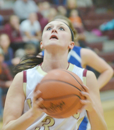 WARREN DILLAWAY / Star Beacon<br /> KELSEA BROWN of Pymatuning Valley drives to the basket on Monday during a home game with Hubbard.