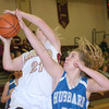 WARREN DILLAWAY / Star Beacon<br /> GEENA GABRIEL (21) of Pymatuning Valley tries to drive by Morgan Kist of Hubbard on Monday evening in Andover Township.