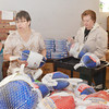 WARREN DILLAWAY / Star Beacon<br /> ALICE HARDEN, site coordinator for the Ashtabula Salvation Army, (left) and Peggy Senskey, a Signature Health volunteer, prepare turkeys for distribution on Monday morning at the Ashtabula Salvation Army.