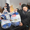 WARREN DILLAWAY / Star Beacon<br /> NILDA ALAMEDA of Ashtabula was all smiles while visiting the Salvation Army on Monday in Ashtabula. Hundreds of turkeys were distributed to the needy on Monday.