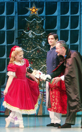 WARREN DILLAWAY / Star Beacon<br /> MIRANDA DIFRANCO, Clara, (left) receives the Nutcracker from Ralph Bacon (right), Drosselmeyer, with Garrett Bacon, Drosselmeyer's nephew, (back center) looking on during the Ashtabula Arts Center's rendition of the Nutcracker.