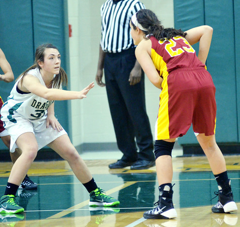 WARREN DILLAWAY / Star Beacon<br /> ALEXIS BENEDICT (left) of Lakeside defends Jaclyn Yankle of Cardinal Mooney on Tuesday night at Lakeside.